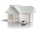 House miniature with car isolated in white background for real estate and construction concepts. House miniature designed and created by contributor