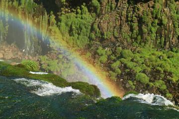 Impressive view of a huge rainbow over the Iguazu falls, Foz do Iguacu, Brazil, South America