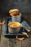 Homemade autumn organic pumpkin soup in a vintage metal mugs on a dark grey wooden rustic table. Close up - 222536208