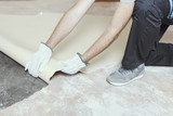 Contractor removing an old linoleum flooring - 222537883