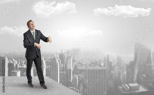 Fototapeta samoprzylepna Zombi elegant businessman on the top of the city