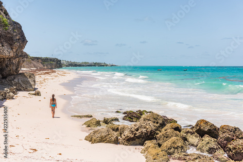 Foto Murales Barbados beach girl on cruise vacation walking at Ginger beach famous tourist travel destination.