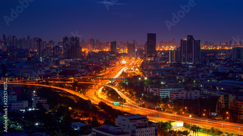 panorama view of light tail on cityscape background - 222574071