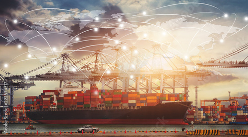 Leinwanddruck Bild Business Logistics concept, Global network coverage world map,Truck with Industrial Container Cargo for Logistic Import Export at yard