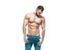 Leinwanddruck Bild - bodybuilder posing. Beautiful sporty guy male power. Fitness muscled in blue jeans. on isolated white background.