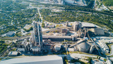 Aerial view of cement manufacturing plant. Concept of buildings at the factory, steel pipes, giants. - 222586408