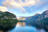 Scenic view of Hallstatter lake with a rainbow in Austrian Alps. Autumn sunset on Hallstatt lake with beautiful clouds and reflections of the sky in the water - 222591639