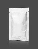 aluminum foil snack sachet isolated on gray background - 222600262