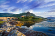 Leinwanddruck Bild - Tourists favourite place in Scotland - Isle of Skye. Very famous castle in Scotland called Eilean Donan castle.  Top of the mountains.Scottish Highlands. Castle with reflection in the lake.