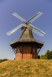 Windmill on a sunny day - 222619673