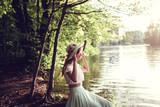 Romantic outdoors shots of stylish brunette beauty in autumn park