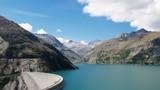 Hyper lapse of Kolnbrein Dam and Kolnbreinspeicher lake in Carinthia, Austria. - 222651435