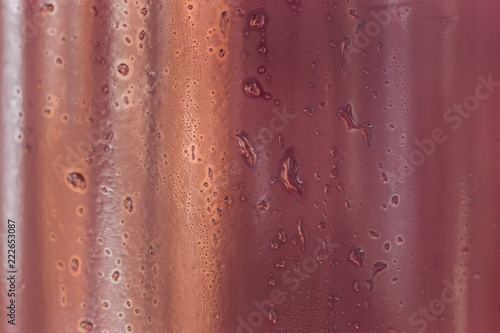 drops of water on a dark plastic bottle beautiful abstraction - 222653087