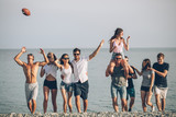 Multiracial Group of Friends Walking at Beach, having fun, womans piggyback on mans, funny vacation