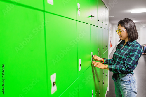 Green automated self service post terminal machine or locker to receive a parcel or to deposit the luggage for storage - 222661486