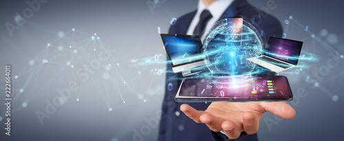 Leinwanddruck Bild Modern devices connected in businessman hand 3D rendering