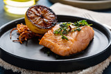 Salmon Sole Meuniere with lemon. Fillet of red fish. Steak trout fried with butter, lemon and parsley sauce - 222691898