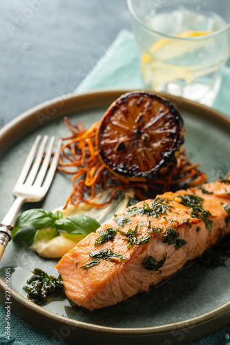 Leinwandbild Motiv Salmon Sole Meuniere with lemon. Fillet of red fish. Steak trout fried with butter, lemon and parsley sauce