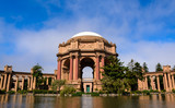 The Palace Of Fine Arts Theatre In San Francisco Front Facade With Large White Dome And Pond In Front Surrounded By Trees