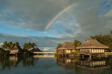 Rainbow over resort buildings at Bora Bora, Society Islands, French Polynesia.
