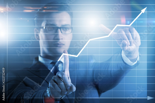 Leinwanddruck Bild BUsinessman pressing virtual button on diagram chart