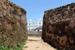 The Meera Mosqe within the Galle Fort, seen from between of two rocks