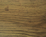 Decorative surface imitating the texture of a dark aged oak.