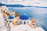 Santorini Greece Europe luxury travel vacation getaway. Famous tourist attraction Three Blue Domes church view in Oia village. European destination greek island. - 222741821