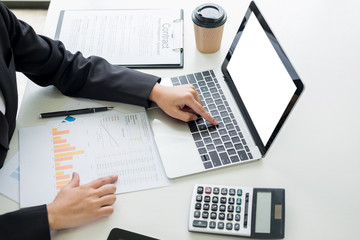 business woman with laptop, Business team working on a new business plan with modern digital computer, finance graph and writes on a document at her office