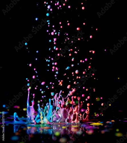 Fototapeta Dancing color ink on black background