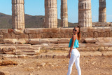 stylish young girl near the ruins of ancient Greece - 222761240