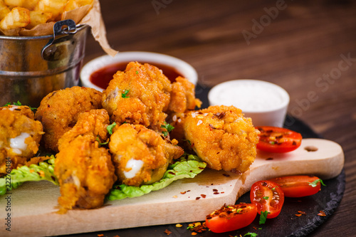 Fried chicken drumsticks with French fries and vegetables - 222761484