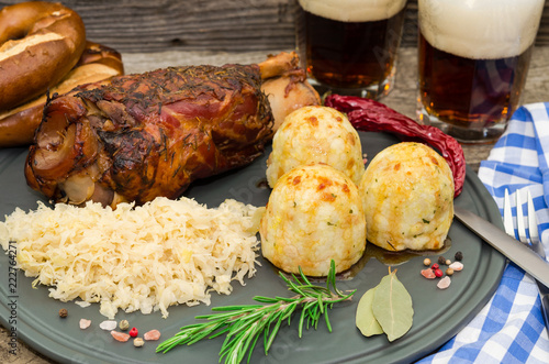 Leinwandbild Motiv  Grilled pork knuckle. Pork knuckle with beer, dumpling and sauerkraut. Oktoberfest. Grillhaxe