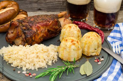 Grilled pork knuckle. Pork knuckle with beer, dumpling and sauerkraut. Oktoberfest. Grillhaxe  - 222764271