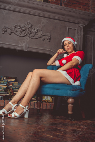 Cute girl dressed as Santa Claus. Happy New Year and merry Christmas!