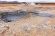 Gray hot mud pots in the Geothermal Area Hverir in Iceland