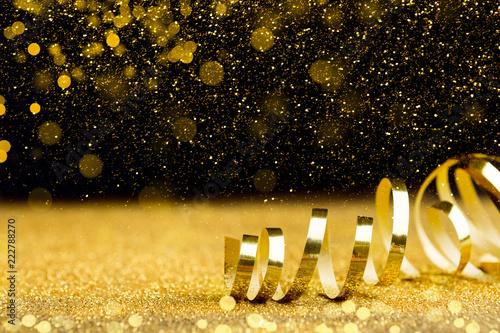 Święta Bożego Narodzenia tło z złote wstążki