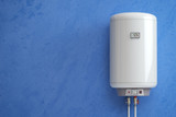 Electric boiler, water heater on the blue wall. - 222792481