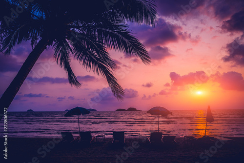 Leinwanddruck Bild Beautiful tropical beach with palm trees. Sunrises and sunsets. Ocean