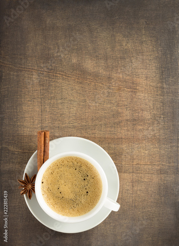 cup of coffee and anise with cinnamon stick