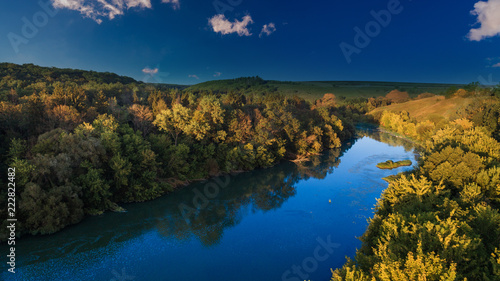 Foto Murales drone with a camera, beautiful summer small river from a height