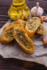 fragrant garlic bread on a rustic wooden background