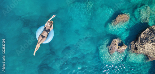 Aerial view at the girl on sea. Turquoise water from air as a background from air. Natural seascape at the summer time. Seascape from drone - 222827095