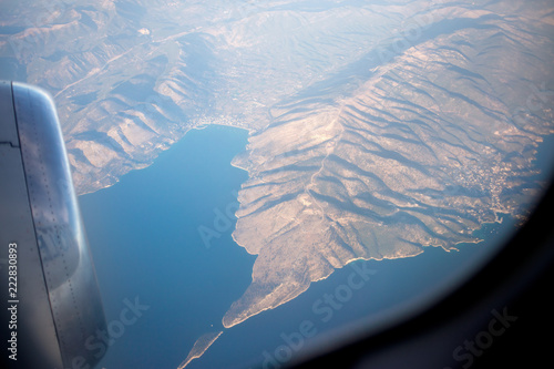 flying and traveling, view from airplane window on the wing - 222830893