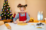 Girl baking Christmas cookies - 222850864