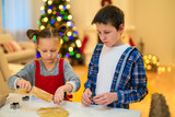 Kids baking Christmas cookies - 222851013