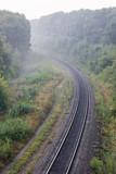 Summer morning landscape. Empty railroad turn in sunrise mist - 222857613