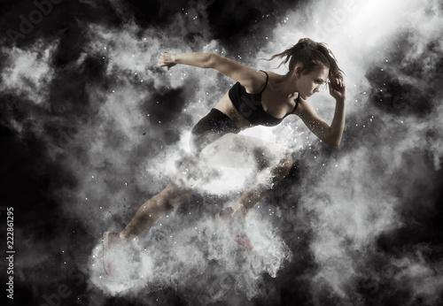 Woman sprinter leaving starting