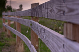 Wooden Paddock Fence with Three Railings - 222872843