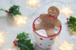 Gingerbread cookie man in a hot cup of chocolate
